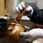 """Kenji Suzuki, Urushikaki artisan (drawing sap from ""urushi"" tree), Urushi painter"" Working with lacquer at Jyoboji Temple in Iwate"